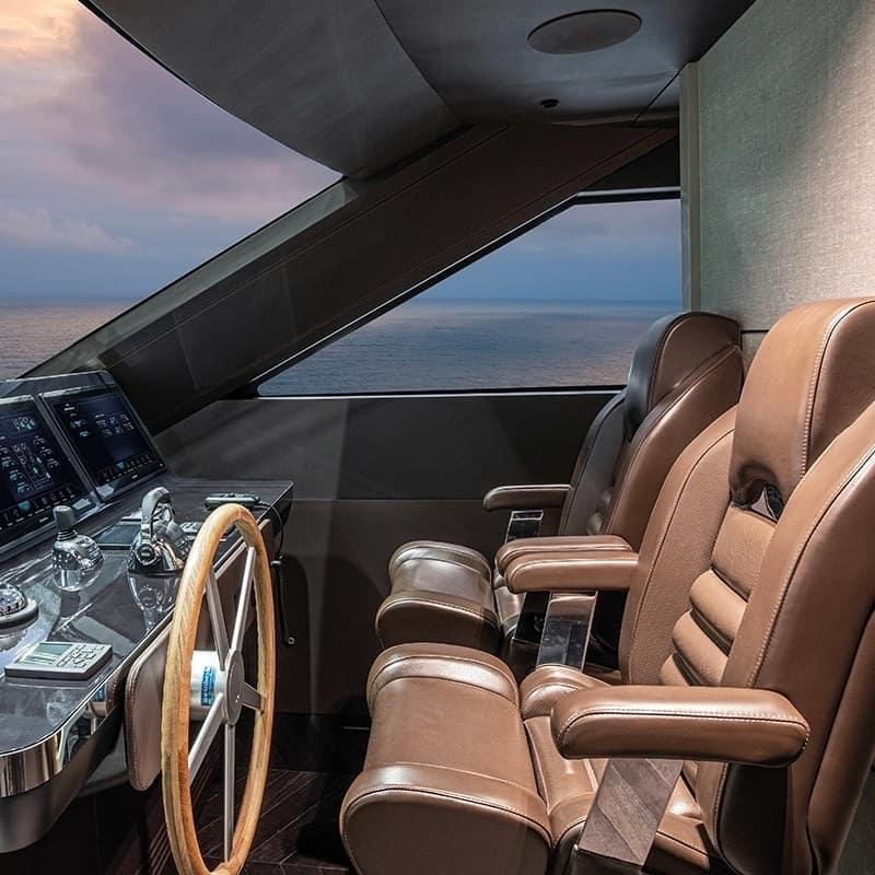 ladybird helm seat in tan leather on cranchi motoryacht - besenzoni - gineico marine